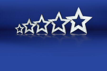 restaurant rating: Five Star Rating 5 silver stars in ascending order on blue background copyspace