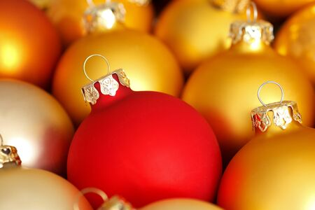 yule tide: Traditional round Christmas tree ornaments in colorful red and gold