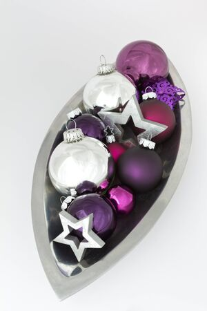 'yule tide': Christmas decoration bowl with tree balls and stars in silver, violet and purple on white