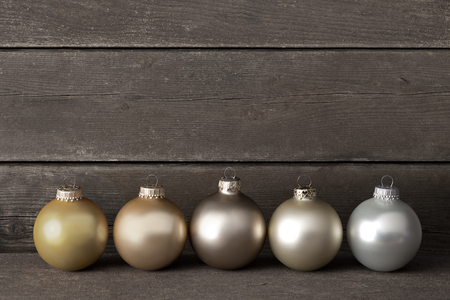 muted: Christmas tree balls in muted colors on dark wood, vintage, retro, filter effect, copy space