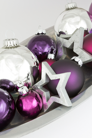 christmas tide: Christmas tree ball ornaments and stars in silver and violet, colorful and bright