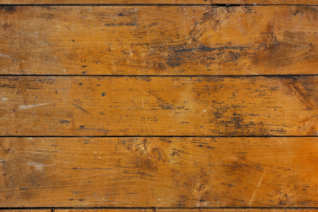 floorboards: Antique wooden floorboards with stains and wood worm galleries, background, copy space
