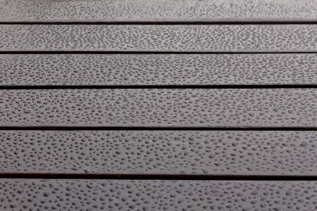 oiled: Dark oiled wood with water drops, reflections, background, copy space