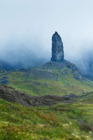 skye: Rock pinnacle the Old Man of Storr with mist or clouds, at Skye, Scotland, copy space