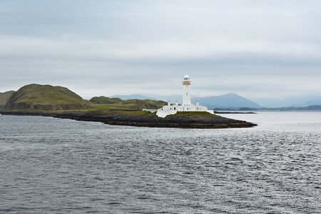 mull: White lighthouse Eilean Musdile between Lismore and Mull, hebrides, Scotland, copy space
