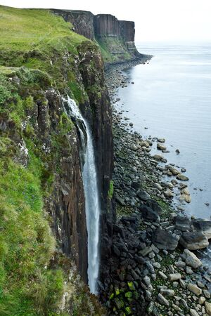 upright format: Waterfall Kilt Rock in summer at the Trotternish peninsula of Skye, Scotland, upright format