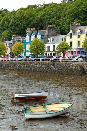 Mull: Colorful houses of Tobermory with boats at low tide, on the Isle of Mull, Scotland