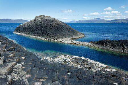 Dark basalt columns at the coast of the scottish isle of Staffa, inner hebrides, copy space