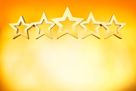restaurant rating: Five golden shiny stars on bright yellow background, blazing sunlight, copy space