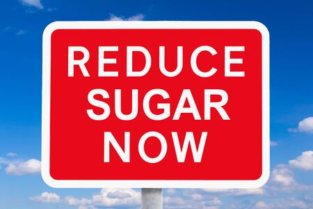 carb: Red and white signpost REDUCE SUGAR NOW  in front of a blue sky with a few white clouds, spoof of british road signs