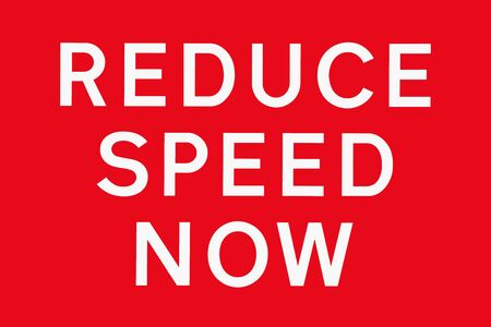 slow down: White text on red background REDUCE SPEED NOW, road signs in the UK, symbol for dangerous road