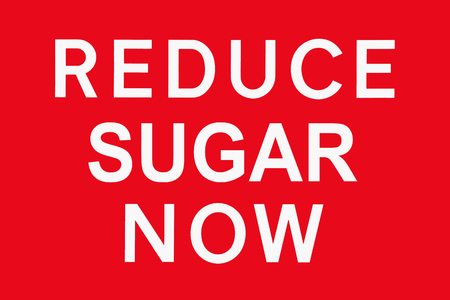 White text on red background REDUCE SUGAR NOW, symbol for health threat, spoof of british road signs Stock Photo