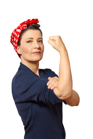 Strong and self-confident woman with a clenched fist rolling up her sleeve, vintage or retro effect of the 40s in America, isolated on white, copyspace