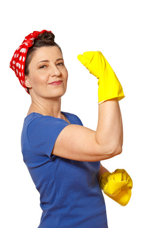 Cheerful char with red kerchief, yellow cleaning gloves and cloth, holding up her arm and showing her muscles, isolated on white, copy or text space,