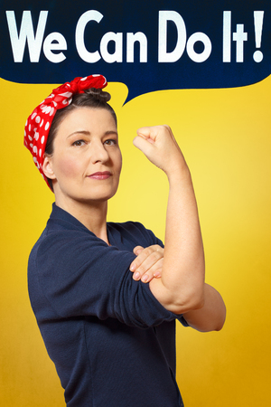 We can do it text bubble in photo of a strong and proud woman with a red headscarf rolling up her sleeve, perfect tribute to the classic american poster of rosie the riveter