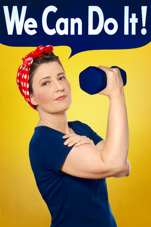 Rosie the Riveter with red kerchief and blue t-shirt lifting a weight in front of yellow background, WE CAN DO IT text in speech bubble on top Imagens
