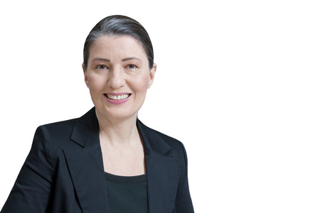 Friendly smiling middle aged woman in a black blazer isolated on white background, professor, teacher, translator, lawyer, attorney, accountant or businesswoman