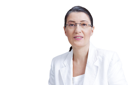 Middle aged woman with eyeglasses in white blazer isolated on white background, professor, teacher, private tutor, personal coach, counselor, psychologist or therapist