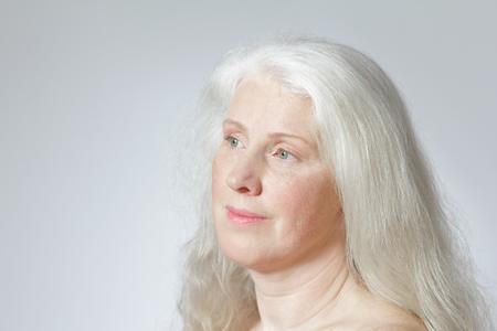 Headshot senior woman long white hair