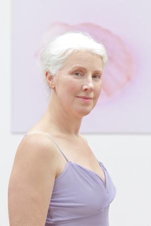 portrait senior woman pink background