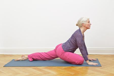 Senior woman yoga copy space Stok Fotoğraf