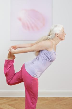 Senior woman yoga exercise dancer