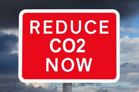 warning sign REDUCE CO2 NOW Imagens