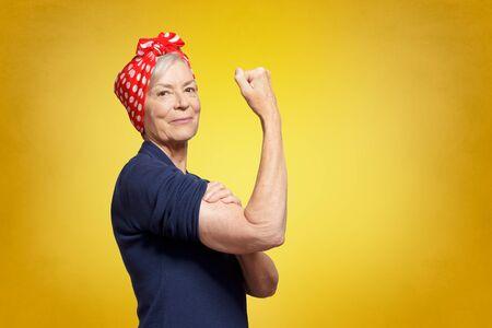 self-confident senior woman rosie riveter