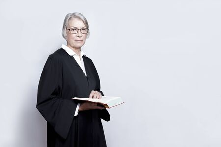 Female judge lawyer advocate gown Stock Photo