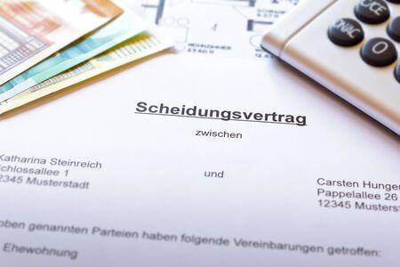 Divorce settlement contract paper in german with money, floor plan and calculator: scheidungsvertrag.