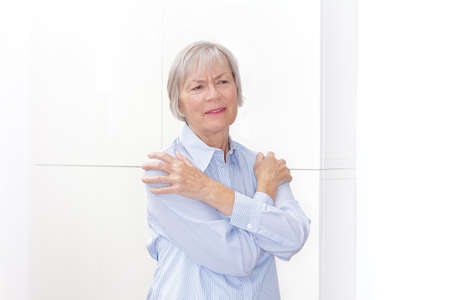 Polymyalgia rheumatica: senior woman suffering from acute pain in her upper arms.