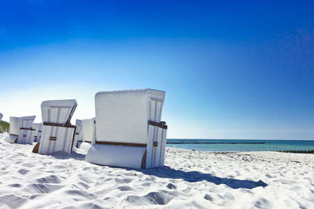 White beach chairs on an empty beach at Ahrenshoop on the Fischland-Darss-Zingst peninsula, Germany.