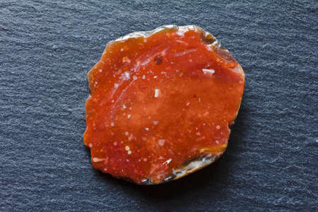 Red flintstone of Helgoland, or Heligoland, a sort of flint stone that is found only on this german island in the North Sea. 免版税图像