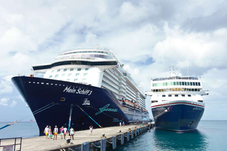 ST GEORGES, GRENADA - JANUARY 6, 2018: Cruise ships Mein Schiff 3 and Braemar, frontal view docked in the Caribbean.