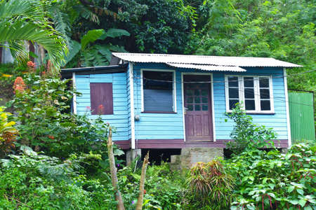 ST GEORGES, GRENADA - JANUARY 6, 2018: Countryside housing on the caribbean island of Grenada, wooden shak house.