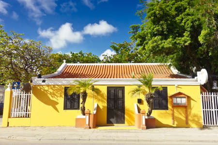 KRALENDIJK, BONAIRE - JANURY 8, 2018: Yellow restaurant building in Kraledijk, Bonaire, Dutch Antilles, Caribbean Sea.
