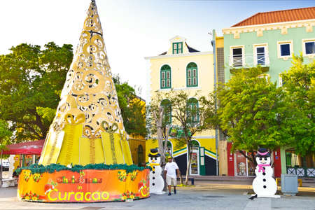 WILLEMSTAD, CURACAO - JANUARY 9, 2018: Colorful Christmas tree and snowman decorations in Willemstad, Caribbean.