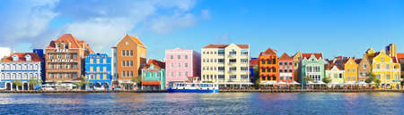 Willemstad, Curacao - January 9, 2018: panoramic view of the iconic and colorful buildings at the waterfront, west indies, caribbean. Éditoriale