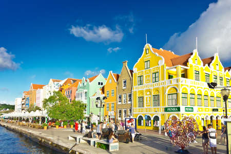 Willemstad, Curacao - January 9, 2018: colorful buildings at the Handelskade harbor waterfront, West Indies, Caribbean. Éditoriale