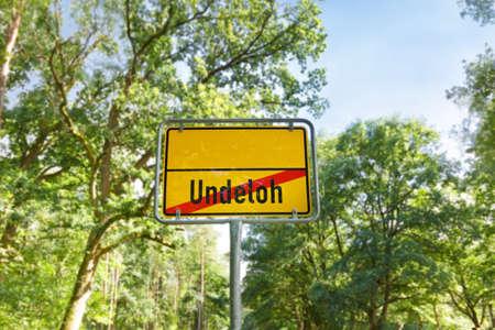 Unusual yellow German town sign