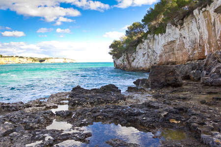 On the rocks of popular Cala Llombards, balearic island of Majorca or Mallorca, in winter. View in direction of Cala Santanyi.