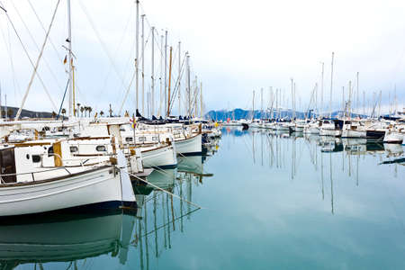 The yacht marina of Port de Pollenca on a windless day in winter, balearic island of Majorca or Mallorca.