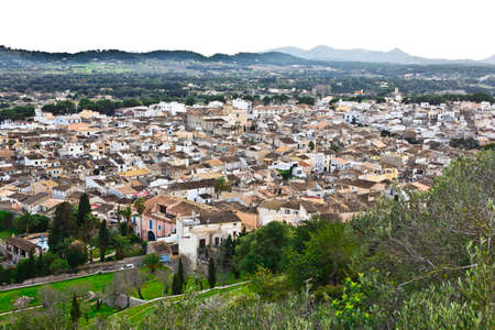 Arta, Majorca or Mallorca, Spain - January 29, 2015: Panoramic view over the roofs of the old town in soft evening light. Éditoriale