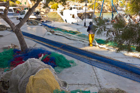 Cala Figuera, Majorca or Mallorca, Spain - Feburary 3, 2015: fisherman with modern plastic fishing nets and some of traditional material. Éditoriale