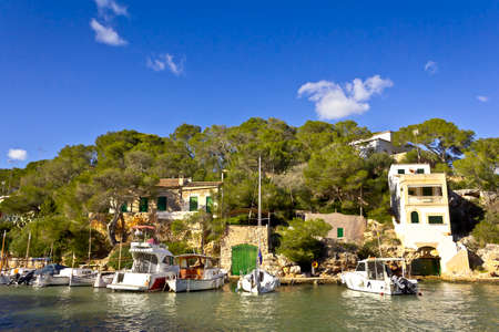 Cala Figuera, Majorca or Mallorca, Spain - Feburary 3, 2015: houses and fishing boats in a picturesque bay of the popular seaside town. Éditoriale