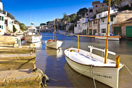 Cala Figuera, Majorca or Mallorca, Spain - Feburary 3, 2015: white fishing boats in a picturesque bay of the popular seaside town. Éditoriale