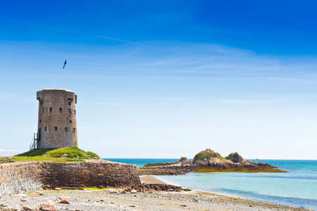 Le Hocq Tower and Common on the south shore of Jersey, Channel Islands, Britain, on a sunny summer day.