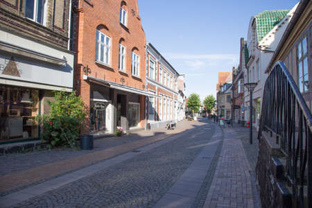 pitched roof: Small shopping street deserted in Rudk?bing Editorial
