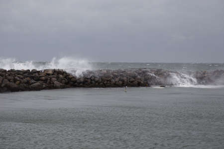 breakwaters: Waves break on the breakwater in the port of Bagenkop, Langeland