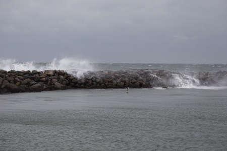 breakwaters: Waves break on the breakwater in the port of Bagenkop, Langeland
